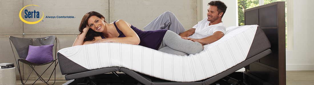 Man and women on curvy mattress with Serta Logo